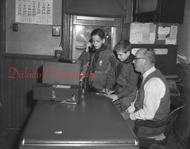 """(02.16.56) Boy Scouts """"Take Over"""" the borough of Mount Carmel for a day. Checking phone calls at the borough switchboard are Jerry Wisko and Matt Merges, guiding by E.J. Fincato, borough secretary."""