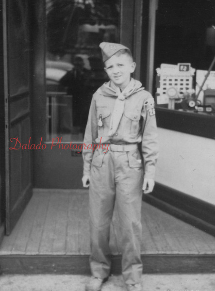 Boy Scout at store.