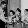 (05.13.59) Robert Kearney, a sergeant of Shamokin Police Department and coordinator of the school safety patrol program, issued coin containers and tags at City Hall in connection with the school patrol Tag Day. Patrol members are, from left, Arthur Jaffe, William Hudson and William Schmidt.