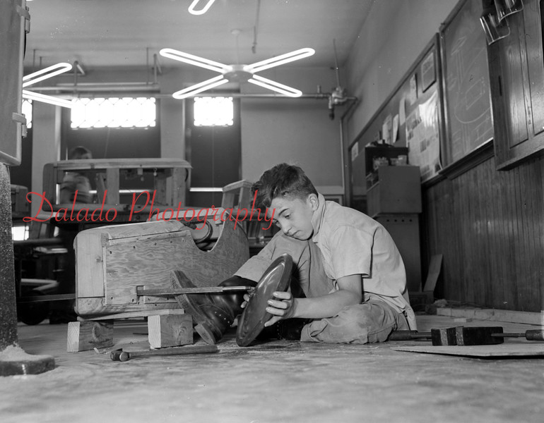 (July or Aug. 1956) Cub Scouts making cub mobiles.