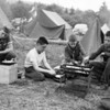 (May 1958) Over their portable stove is James Maurer, John Kelley, Michael Brennan and Richard Klemick, of Troop 252, St. Joseph's Church, Shamokin.