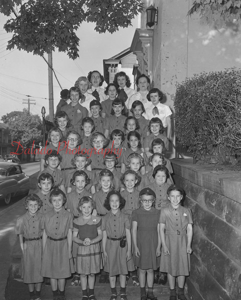 (06.03.54) New uniforms for Brownies are, front row, from left, Carol Jeremiah, Carol Ann Thew, Donna Ponatoski, Jean Shroyer, Betty Shaffer and Grace Shaffer; second, Sherry Goss, Rose Ostic, Donna Jenkyns, L. Ponatoski and Becky Spatzer; third, Linda Richards, Phyllis Nuss, Marion Miller, Jean Shebelsky and Sandra Eveland; fourth, Judy Reese, Cindy Wiley, Jacqueline Wiley, Hope Friedman, Nancy Whitley and Frances Ann Shaffer; fifth, Linda Strausser, Susan Anderson, Susan Shroyer and Linda Pantalone; sixth, Joanne Hand, Janice Jenkyns, Louisa Wanacott and Sally Harner; seventh, Mildred Welsh, Catherine Frye and Sandra Harner; eighth, Sarah Wiley, Ruth Reed and Margaret Ponatoski, directors