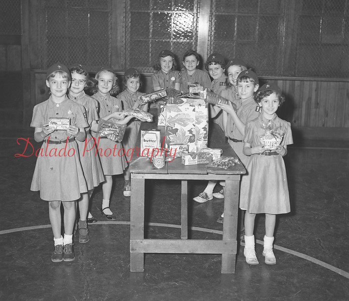(11.28.57) Brownies from First Presbyterian Church are, from left, Louis Hoover, Ruth Williams, Linda Stainia, Gail Shoop, Dorothy Hepner, Maureen McAllister, Margaret Moore, Sarah Jane Fleming, Iris Fegler and Cheryl Kappen. Senior leaders are Mrs. Miriam Milbrand, Mrs. Bernice Milbrand, Lillian Heedner and Gene Woodley.