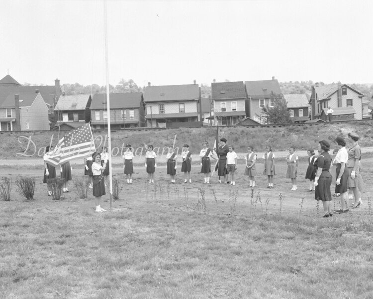 (1962) St. Anthony's Girl Scout troop raising the flag at Ranshaw.