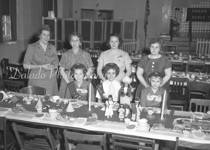 (March 1961) The second of two banquets for the 205 members of the Pine Cone Intermediate Girl Scout Troop, Ashland, was held at Loeper Hotel. Pictured are, seated, from left, Trudy Lee Miller, Barbara Zimmerman and Donna Bensinger; standing, Lois Young, troop leader; Mrs. Otto Miller, Mrs. Kenneth Zimmerman and Mrs. Clyde Bensinger.