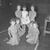 (12.15.57)  Brownies from Troop 16, First Presbyterian Church, prepare a scrapbook for Suzette Marcinek, who was injured in an accident at her home, are, kneeling, from left, Naomi Fegley, Cathy Milbrand, Jane Hoffman and Jennifer Boivers; standing, Sandra Milbrand, Deanne Marcinek, sister of the injured girl, and Joanne Shroyer.