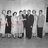 (05.20.54) Louis Rona, District Manager of the ILGWI, is shown presenting Mildred Balon with transfer papers to her new job as a business agent in Pottsville. Pictured are, from left, Mildred Dick, Evelyn Michelson, Dorthy Zigarski, Mildred Balon, Martin Roseto, Louis Rona, Gloria Hendershot and Owen Griffiths.