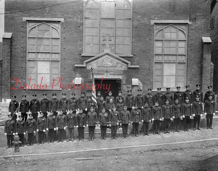 (1917) Society of Polish Cadets in front of St. Stan's. - Pictured are, front row, from left, A. Ciebera, J. Sobieski, C. Egick, A. Antas, J. Mik, B. Obinski, Unk., J. Mik, L. Namietkiewicz, L. Pasierb, Unk., A. Boginski, B. Mroz, P. Egick; back, W. Pizlo, J. Pasternik, V. Pstroch, Unk., P. Milek, J. Dziadosz, P. Ciupack, F. Bebenek, J. Bieranski, Rev. P. Topolinski, T. Wawroaski, Unk., B. Raczkowski, G. Koszur, S. Koszur, I. Pasierb, F. Szozepanski, J. Orlowski, Unk., S. Kuminski, Jablonski, and M. Antas.