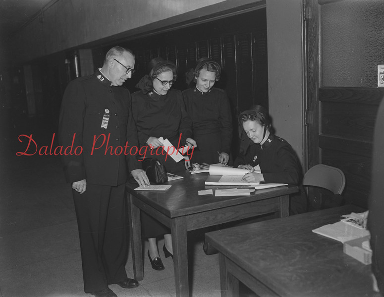 (11.17.1955) Four Salvation Army Officers on Nov. 17, 1955. Pictured are, from left, Capt. Donald Lance, Capt. Dorothy Michaels, Capt. Raines and Major William Dearin.