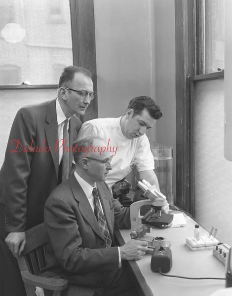 (04.18.57) Shamokin Hospital workers are Dr. Merle Calvin, Robert Thomas and Richard Varano.