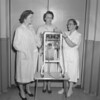 (12.21.52) Shamokin Hospital Auxiliary presenting new machine are William Clements, John Stank, of the auxiliary; and nurse Elizabeth Hayer.