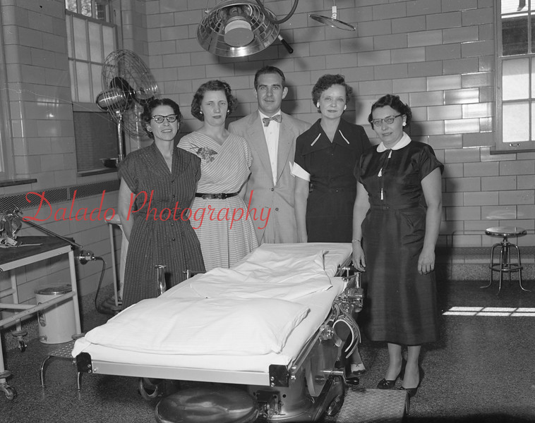 (06.28.53) Additional equipment presented to Shamokin Hospital by the Auxiliary. Shown are Mrs. Evoldo Rosini, Mrs. John Stank, J. William Edler, Mrs. William Cleaments and Mrs. Marlin Kramer.