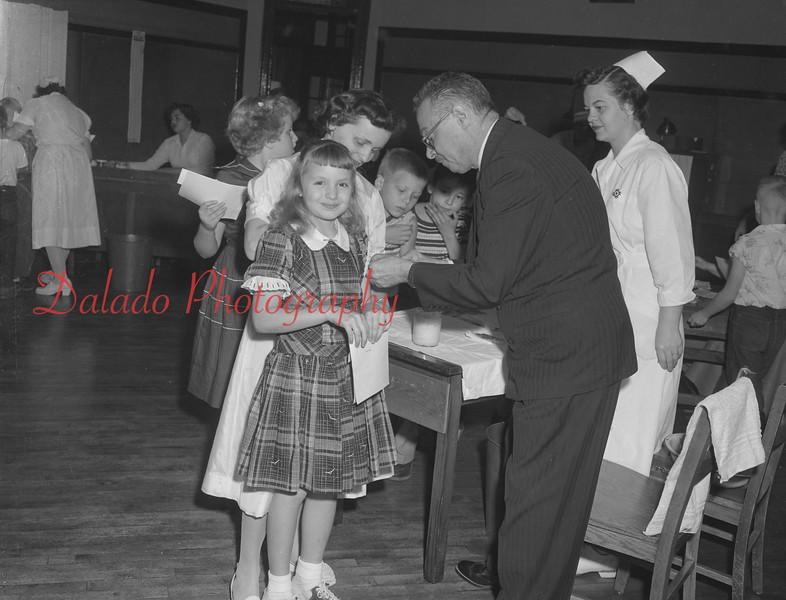 (Oct. 55) Dr. Gennaria giving polio shots.