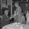 (April 1955) Dr. Baluta examining children.