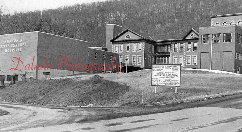 """A portion of the large sign reads, """"renovation of two wards of Shamokin State General Hospital."""""""
