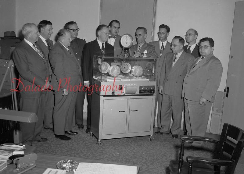 (12.07.52) Elks Lodge of Shamokin presented infant bolete to Shamokin State Hospital. Pictured are, front row, from left, Andrew BiDane, exalted ruler; Russ D., Attorney D.W. Kearney, Jesse Lewis, Frank Miller and Dr. Lionel Gates; second, Eugene Zartman, W.D. Derman, J.W. Edlar, hospital supertendant; Dr. L.N. Ogburn and L.C. Siegfriend.