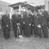 (10.18.59) Shamokin State Hospital groundbreaking of new wing. Project cost was $831,000. Gov. David Lawrence attended the groundbreaking with local physicians and nurses. The new wing will include accommodations for 35 additional patients, an operating room and recovery room.  Prior to governor's address, Michael Stewart, president of the hospital board of trustees, commended are a civic groups and private citizens for their overwhelming interesting in securing an expansion of the state-owned hospital.  Gov. David Lawrence applies a strong left foot to the ceremonial spade. Onlookers are, from left, AJ Caruso, executive director of the General State Authority, and hospital trustees Archer Croll, Michael Stewart, Stanley Kozleskie, Thomas Carr, George Conbeer, master of ceremonies; Michael Wanzie and Stephen Jepko.  Msgr. Dennis Reardon, pastor of St. Joseph's Church, welcomes Gov. David Lawrence to Shamokin for the ceremonies dedicating the construction of a new wing at Shamokin State Hospital.