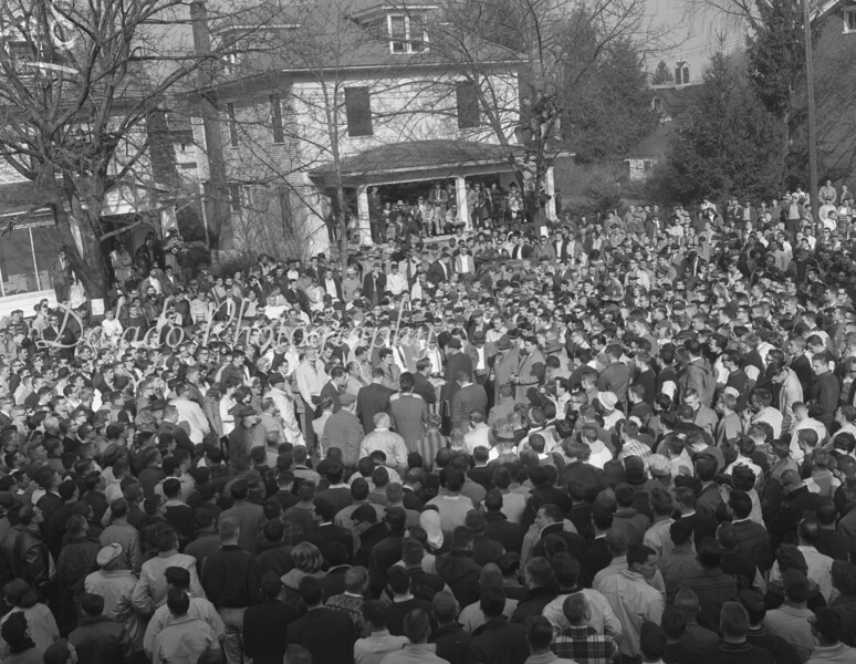 """(Feb.1962) Bucknell University students and some curious residents – and some 80 members of law enforcement – who booed  the would-be American Nazi Fuhrer George Rockwell as he sought to hold a speech in Lewisburg on Feb. 4, 1962. Rockwell and eight cohorts, so-called """"storm troopers,"""" drove to the Civil War Memorial to give remarks."""