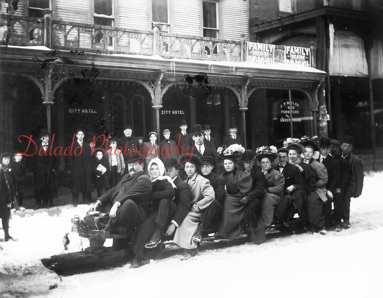 People sledding on Sunbury Street in front of the City Hotel (across from the old Post Office).