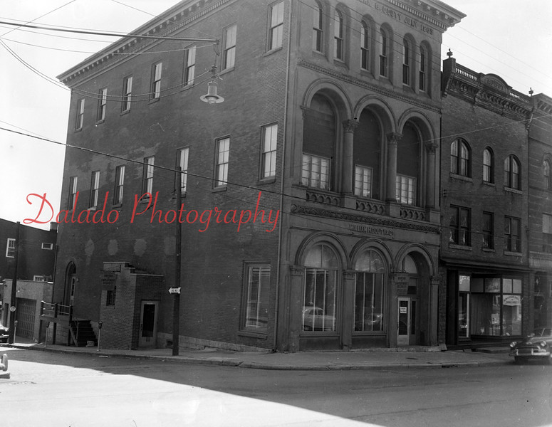 (1955) Brown stone front building at Rock and Sunbury streets.