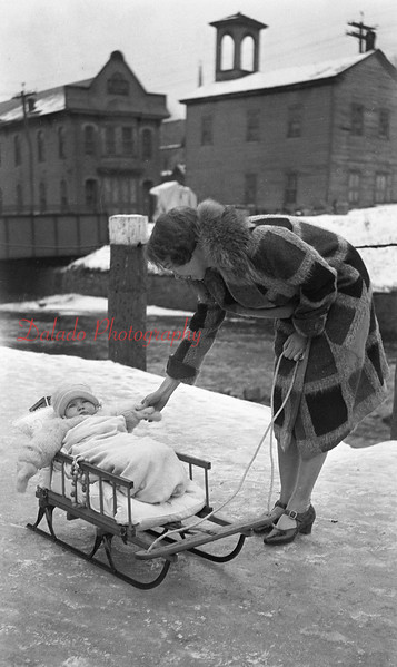 Woman and baby on Water Street in Shamokin.