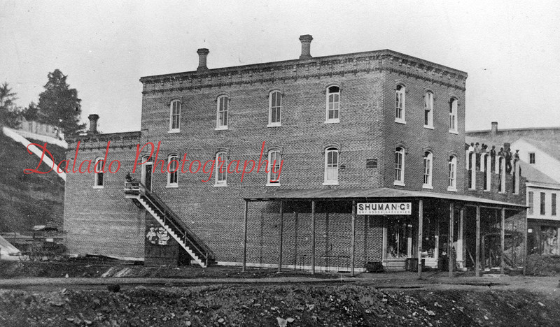 Shuman Company Dry Goods Groceries- The original wooded building was located on the southern side of Independence Street, between Rock and and Washington streets. *The hill in the background is throwing me off to this final location. Will have to investigate this more.*