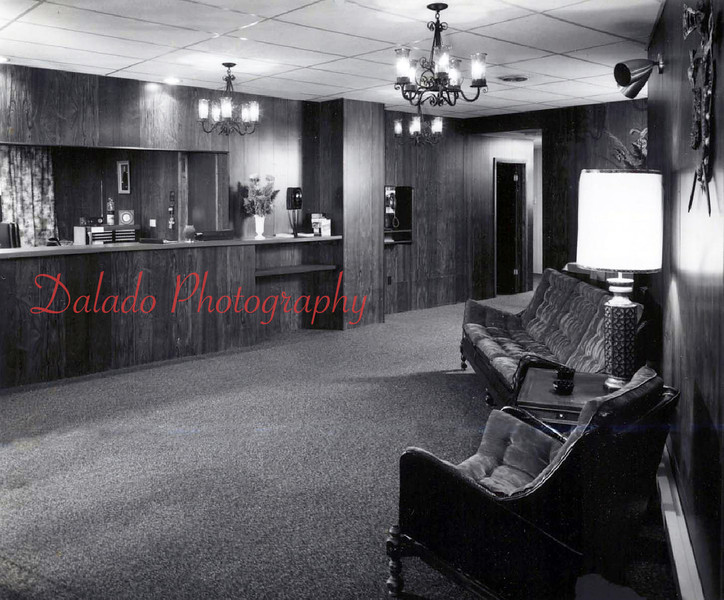 "(1974) The lobby area of Walnut Towers in 1974. [Before being known as the Walnut Towers Inn, and later ""The Coal Hole,"" the building housed the Taubel Knitting Mill, which in addition to a sister building next door, housed around 900 employees...]"