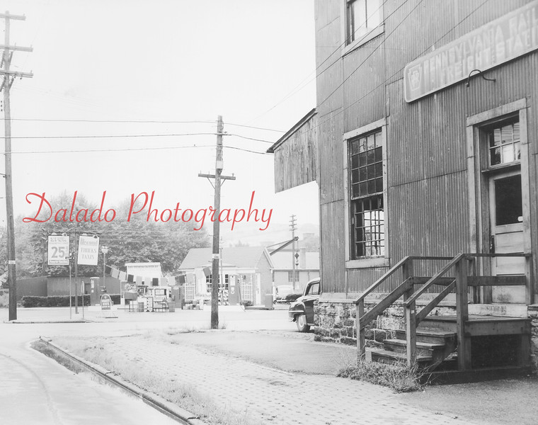 This is at the intersection of Sixth and Walnut streets. The Pennsylvania Railroad Freight Station is at right. Close-up photos of the gas station shown in the background are in the other albums.
