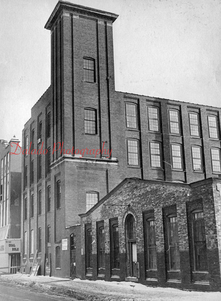 (01.1977) Taubel Knitting Mill, aka. Walnut Hosiery Building, after the fire in 1977. Occupying the building at the time were Fishman Manufacturing Company (first and second floors), and Lark Dress Company (third and fourth floors).