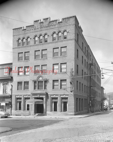 James Madison Hotel- The Graemmar family sold the building in 1923. This photo was most likely taken in the 1950s or early '60s. Shown is a neon sign for the James Madison, and also a barber pole along Commerce Street.