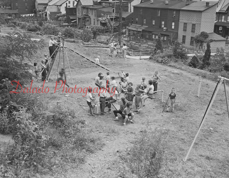 (1956) Rock Street Playground. This area is now overgrown. Most of the homes at right were demolished in the summer of 2013 after they were damaged in the Flood of 2011.