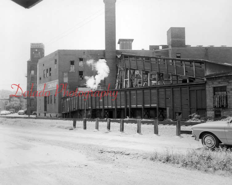 """Brest Packing (later Kreisl Brothers Inc. and Croninger Packing Co.)-  On April 28, 1962, Kreisl, a meat packing plant, closed permanently. Henry Kreisl, owner who employed 50 people, said that he """"could not meet union demands"""" during negotiations for a new contract. The plant had operated since 1939, when the Kreisl brothers acquired it from Harry Brest. The building was lastly occupied by Croninger. The structure was purchased by John Luckens, who then demolished it on Jan. 22, 1974, for parking for his new motel, Walnut Towers."""