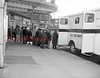 (April 1955) In line for X-Ray examination are these people who were among 770 local residents receiving the test as the mobile unit was stationed in front of the Victoria Theater. The day before, 480 high school students submitted to the X-Rays. In the two-day program, 1,964 received the examination.
