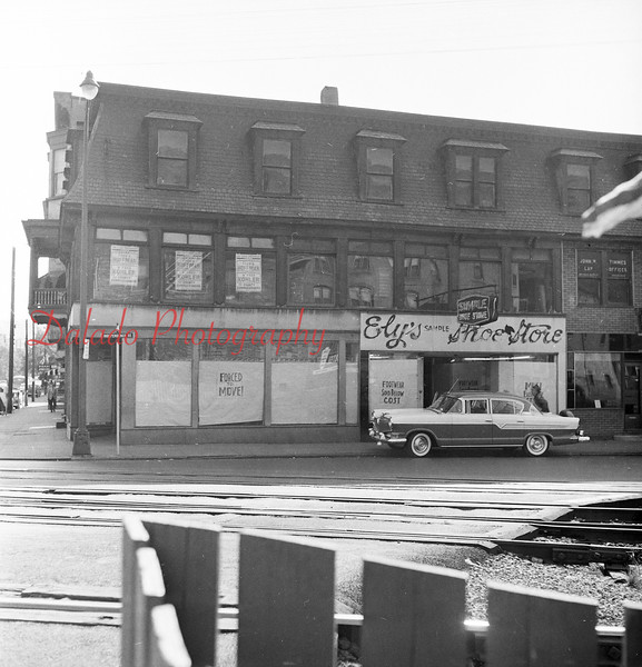 (Oct. 1957) Elys Shoe Store along Independence Street. These buildings were torn down for a bank.