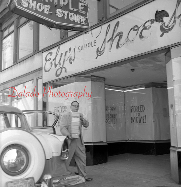 (Oct. 1957) Elys Shoe Store along Independence Street.