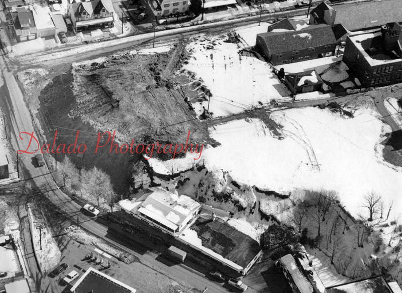 """(Early 1978) Construction of the Coal Township municipal building. This was called the """"Cliff Street Project."""" Several dilapidated homes were purchased, then razed, by the Northumberland County Redevelopment Authority to make way for the building. In January of 1990, the eastern side of the building was expanded by 14-by-30-foot to house a code enforcement office."""