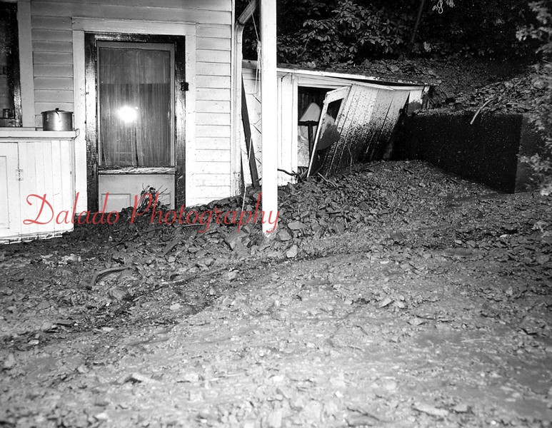 "(05.27.1953) The rear of 121 Dewart Street, owned by A.Z. Marelette, is covered by mud, culm and debris after a ""miniature avalanche"" of the Glen Burn Bank."