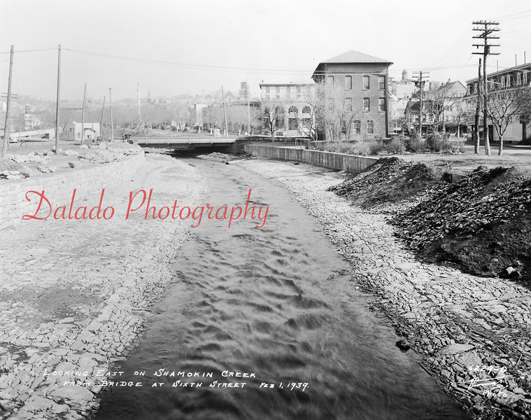 (02.01.1939) Shamokin Creek looking east. Shown is the Moose Mansion (center), Independence Fire Company (center right) and the former Fan Club building (far right).