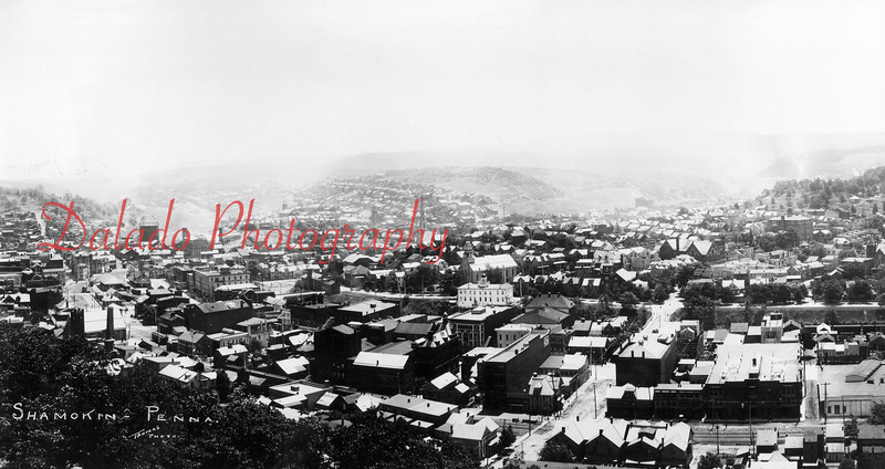 Shamokin- This is one of my favorite photos, and I don't even own it. It is a large photograph, approximately two feet long, with a very high resolution. At center-right, you can see both the first and second Shamokin High Schools. The oddly shaped structure at center-left, in the distance, is the Luke Fidler Colliery. City Hall is the white building at center. (The next two photos are additional images of the photo.)