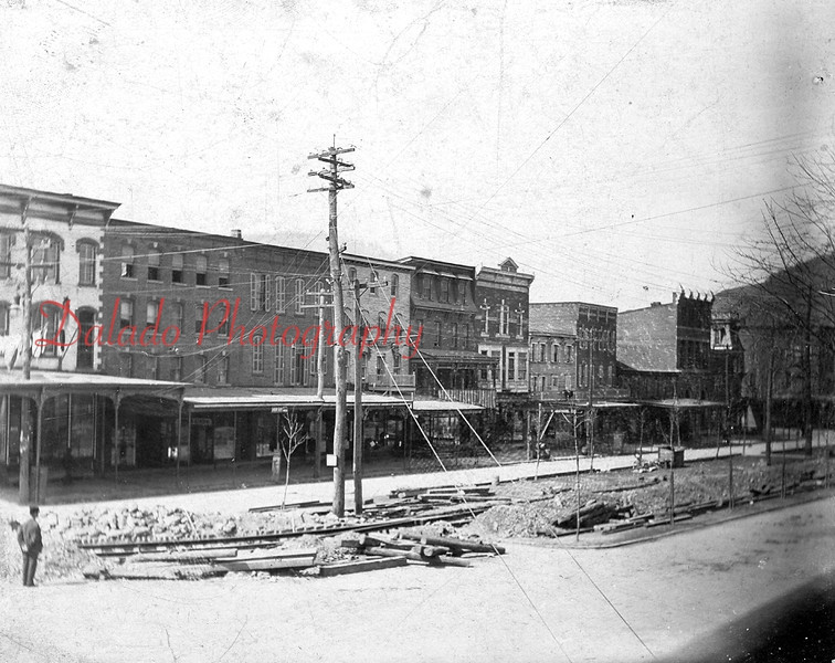 Pictured here is Market Street at Spruce Street, with the camera facing northwest. Wooded ties in the middle of the photo indicate there was work underway on the former Shamokin-Edgewood trolley line, which extended north and south through the park and curved west on Spruce Street.