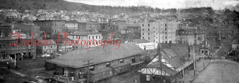 *Low-Res*  Looking east on independence Street is the Reading Railroad Passenger Station with white stucco second floor and the Reading Freight Station to the left. Also seen is the satellite office for F&S Brewery.
