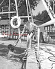 Dick Knoebel helping Marion Vaught out of the pool. (August 4, 1955)