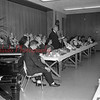 (Feb. 8, 1964) Pa. Music Educators Association presents Northeast District Band at Shamokin High School on Feb. 8, 1964. James Baker, host director; Al. Wright, guest conductor; and James Stoltie, guest soloist. Members are shown enjoying a meal at St. John's United Church of Christ.