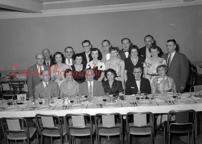 (04.22.54) Barbers and their wives. Seated are, from left, Mr. and Mrs. Harold Rarick, Mr. and Mrs. Lamar Kobel and Mr. and Mrs. Larry Siegfried; second, Mr. and Mrs. John Scandle, Mrs. Dominick Dombrosia, Mrs. Peter Weaver, Mrs. Dixie Richardson, Mrs. Marlin Kramer, Mrs. Leon Misco and Raymond Lauer; third, Joseph Scicchitano, Dominick Dambrosia, Peter Weaver, Dixie Richardson, Leon Misco and Edward Bla