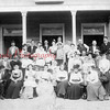 """(1902) """"The Boarding House"""" of George W. Hoch and his wife Savannah Richard, formerly of Shamokin. The building was located on South Shamokin Street near Patsy's Bridge and shows """"mostly Shamokin people."""" Iva Richard, center, and Frank Leader and Mrs. Ralph Pensyl, far right, are some of the people shown in this photo."""