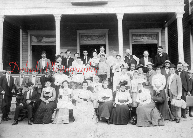"(1902) ""The Boarding House"" of George W. Hoch and his wife Savannah Richard, formerly of Shamokin. The building was located on South Shamokin Street near Patsy's Bridge and shows ""mostly Shamokin people."" Iva Richard, center, and Frank Leader and Mrs. Ralph Pensyl, far right, are some of the people shown in this photo."