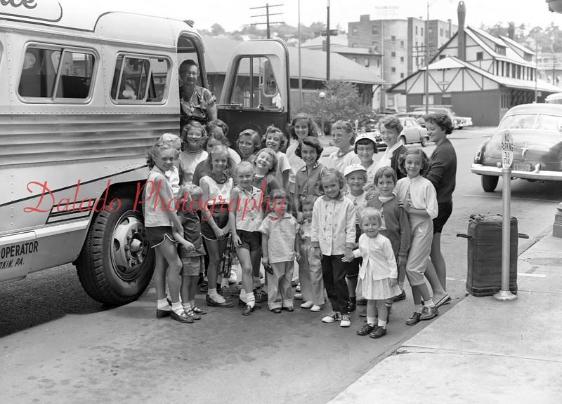 Girls boarding a bus near the train station in Shamokin.