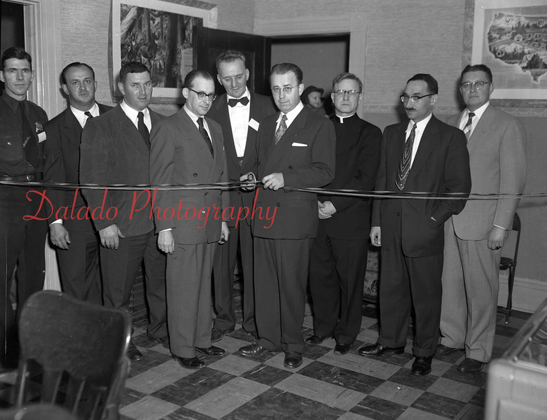 (02.04.1954) Dedication ceremonies of the newly established Boys Club at 716 N. Shamokin St. on Feb. 4, 1954. Pictured are, from left, Robert Kearney, Lewis Delbaugh, John Barretty, Ben Yashan, Joseph Lahnstein, Mayor Fred Kohler, George Mulcahy, pastor of St. Edward's Church. Rabbi Isidore Pickholtz, of B'Nai Israel Synagogue and Sanford Marateck.