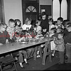 (05.24.1956) Salvation Army. The Junior Legion trains youngsters to make vases. Lt. Doris Reidenbach demonstrates the final step at the Tharptown site, 13th and Tharp streets on May 24, 1956.