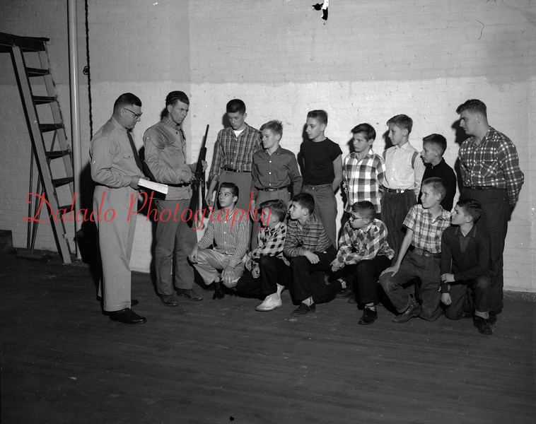 Members of the NRA membership, Coal Township, field sharpshooters. Members of the junior rifle club. Explaining are, from left, Bill Weikel and Walter Hager; Ken Midway, Richard Kolody, Garry Woodley, Michael Hager, James Wheeler and Daniel Olszeinskie; back, Raymond Morgan, Charles Carpenter, Robert Wesoloskie, Richard Bobkaskie, William Mattis, Richard Waraskie and Donald Perry.